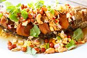 image of snakehead  - deep fried fish with herb and spicy sauce thai food - JPG