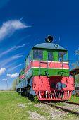 picture of locomotive  - Old style retro locomotive train under blue sky  - JPG