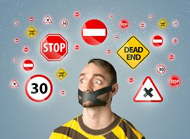 picture of traffic signal  - Young man with taped mouth and traffic signals around his head   - JPG