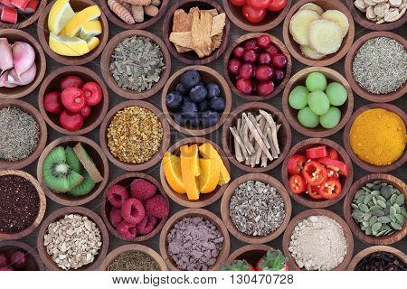 Health and super food  to boost immune system in wooden bowls, high in antioxidants, anthocyanins, m
