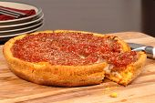 Chicago Style Deep Dish Pizza With A Piece Cut Out