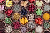 Health and super food  to boost immune system in wooden bowls, high in antioxidants, anthocyanins, m poster