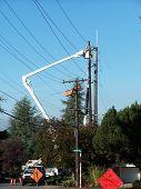 foto of cherry-picker  - street filled with power company trucks - JPG