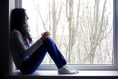 Lonely Girl Near The Window With Cup