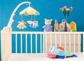 Crib and soft baby toys at children's room. Toys are officially property released.