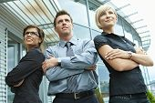 stock photo of team building  - Group of dedicated young business people posing outdoor in front of office building - JPG