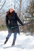 Woman Playing While Shoveling Snow