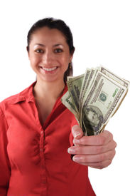 foto of holding money  - a stock image of a smiling latino woman holding money in her clenched fist. isolated on white.