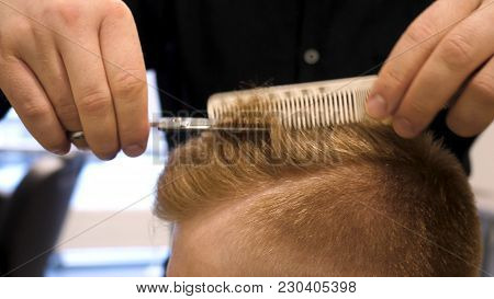 poster of Close Up Of Men's Hair Cutting Scissors In A Beauty Salon. Master Cuts Hair And Beard Of Men In The