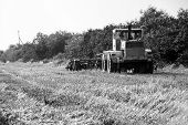 Big Old Tractor Preparing Land For Sowing. Farmer In Tractor Preparing Land With Seedbed Cultivator  poster