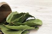 Antioxidant Kitchen Herbs. Spices Of Bay Leaf In Rural Style. Dried Aromatic Bay Leaves In A Wooden  poster