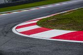 Curving Asphalt Red And White Kerb Of A Race Track Detail poster