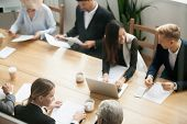Diverse Multiracial Business Team Preparing For Group Meeting Sitting Together At Conference Table,  poster