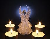 angel with tea lights