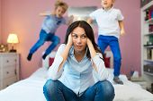 Frustrated mother with children  poster