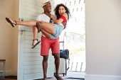 Man Carries Woman Over Threshold Of Honeymoon Rental poster