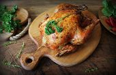 Whole Roasted Chicken With Herb On Cutting Board . Top View . poster