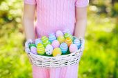 Kids On Easter Egg Hunt With Eggs Basket. poster