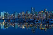Vancouver City Skyline At Night In British Columbia, Canada. Modern Building And Waterfront Marina W poster