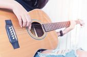 Playing The Guitar. Guitar Lessons. Acoustic Guitar. Relax While Playing The Guitar In Room. poster