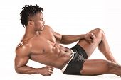 Fit Young Man With Beautiful Torso, Isolated On White Background. The Naked Torso Of African America poster