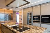 Modern marble kitchen with island. Nobody inside poster