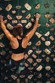 Woman Climbing Indoor Boulder Wall poster