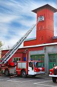 fire station, red fire truck with long ladder, red high tower