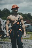 Man, Builder Or Bodybuilder With Strict Face In Hard Hat. Sexy Handyman Concept. Muscular Builder In poster