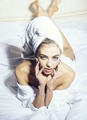 Lady With Pensive Face In Bathrobe Lays On Bed. Girl Enjoys Morning Procedures. Attraction And Desir poster