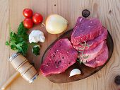 Sliced Red Meat On Wooden Board Tendered With A Meat Pounder. Veal Beef Slices Ready For Schnitzel O poster