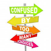 stock photo of confuse  - Several colorful arrow street signs with the words Confused By Too Many Choices - JPG