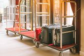 Hotel Luggage Cart / Baggage Trolley In The Hotel Lobby Hallway Background Or Bellmans Luggage Cart poster