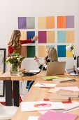 Fashionable Magazine Editors Working With Color Palette In Modern Office poster