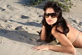 Beautiful Model On The Beach Laying In The Sand