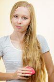 Blonde Girl Brushing Her Long Hair poster
