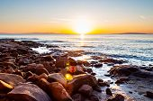 Scenic Rocky Beach Cala Violina Landscape At The Sunset. The Sun Is Going Down Behind The Horizon. T poster
