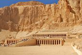 stock photo of mortuary  - Mortuary Temple of Queen Hatshepsut is located beneath the cliffs at Deir el Bahari on the west bank of the Nile near the Valley of the Kings in Egypt - JPG