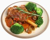 Lamb shank with vegetables dinner