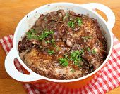 Coq au vin, chicken casseroled in red wine.