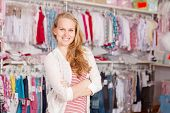 woman shopaholic in clothes shop