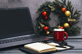 1 Mug Of Cocoa With Marshmallows Next To The Laptop And Diary, Christmas Wreath With Golden And Red  poster
