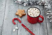 Red Mag Of Drink With Candy Cane And Christmas Gigerbread On Wooden Background. Christmas Greeting C poster