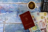 The Hungarian Passports And Different Hungarian Forints Banknotes With Cup Of Delicious Hot Coffee A poster