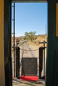 stock photo of caboose  - A look through a vintage caboose as it goes along a railroad - JPG