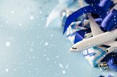 Christmas Travel Planning. Traveling As Gift. White Blank Model Of Passenger Plane, Passports And Gi poster