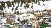 Panorama Houses And Cabins On A Mountain Blanketed With Snow In Park City Utah In Winter poster