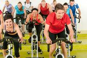 foto of enthusiastic  - Spinning class sport people exercise at gym enjoy workout - JPG
