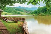 Place For Rest On The Shore Of Mountain Lake. Beautiful Nature Scenery In Spring Time.place For Rest poster