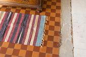 Handmade Carpet On An Old Retro Tiled Floor, Carpet On The Floor poster